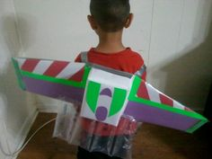 Buzz Lightyear wings from cardboard, paper, bags of air from packages & duct tape.