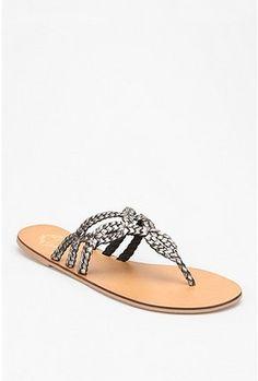 silver flip flops.