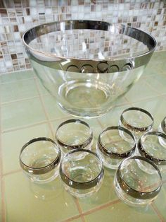 Joy here's one with a bowl.    Silver Rimmed Punch Bowl // 8 Roly Poly Glasses // Mad Men Party Barware. $75.00, via Etsy.