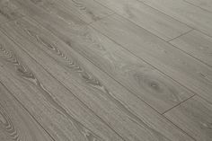 Explore our wide range of high-quality Laminate Flooring! Grey Laminate Flooring, Hardwood Floors, Floors Direct, Grey Oak, New Kitchen, Woods, Wood Floor Tiles, Wood Flooring, Grey Laminate Wood Flooring