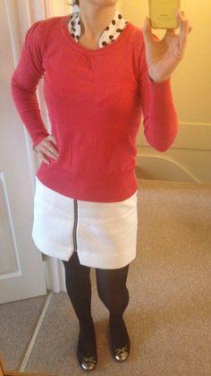 White skirt, black tights, white polka dot shirt, orange jumper