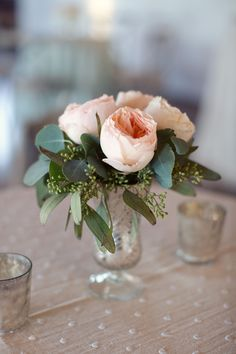 Simple but elegant table arrangement! #bflive Read More: http://www.stylemepretty.com/2014/05/06/urban-english-garden-inspired-wedding/