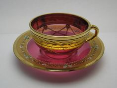 "Cranberry Pink Glass Tea Cup And Saucer Demitasse, The cup is almost 1¾"" (4 cm.) tall and the saucer is 4¼"" (11 cm.) in diameter."