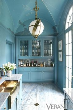 Stunning!    Frankly unbelievable bar and butler's pantry dressed in a nuanced, semi gloss peacock-y blue, brass, and marble reminiscent of the Milky Way which fits perfectly with the astronomical light fixture and constellation mural on the vaulted ceiling. By Miles Redd, obviously.
