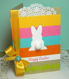 handmade Easter card ... luv the colors ... bunny die cut from background made of strips of papers ... the negative space is left white with a fluffy cotton tail ...