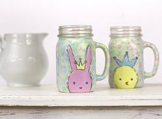 Sweet Easter Bunny and Chick Mugs -- This bunny and chick mug set takes on a regal tone with Americana Gloss Enamel paints. #decoartprojects