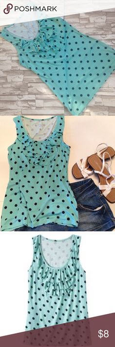 Merona Ruffled Tank Gently worn tank, with polka dots and ruffle on the chest. So cute!! No fading or signs of wear. Mint color with black dots. LAYING FLAT MEASUREMENTS: shoulder to hem, 26 inches. Arm to arm, 15 inches. Merona Tops Tank Tops