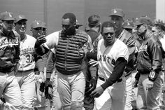 Aug. 22, 1965 in San Francisco's Candlestick Park.  Willie Mays leading John Roseboro after his fight with Juan Marichal.