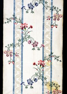Spitalfields brocaded silk, c. 1746. The white ribbon stripe was translated to a printed textile in the Copp Quilt at the Smithsonian in the 1770s. T.257-1973.