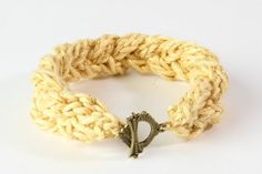 Yellow knitted bracelet.