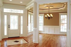 The use of board and batten-esq in a dining room that is traditional in tone