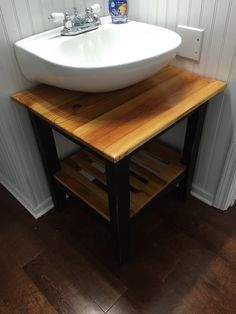A reclaimed wood lavatory stand for half bath.