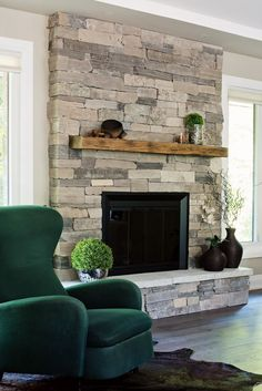 stack stone fireplaces with plasma TV mounted For the Home