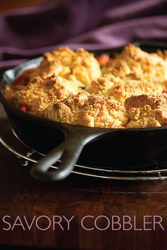 This is a savory cobbler with sausage and red peppers baked under a polenta cobbler topping.