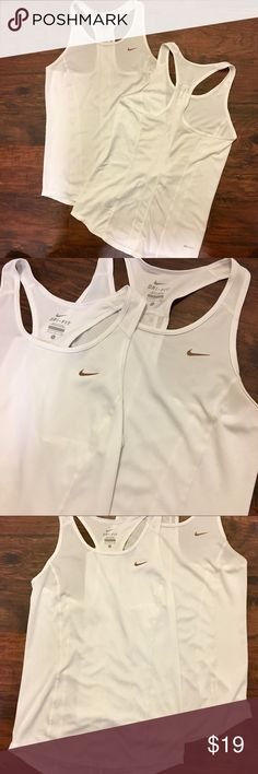 TWO DEAL NIKE DRI FIT WHITE RACERBACK TANK TOPS Hi! Pair of Two Nike Dri - Fit Racerback Style Work Out Athletic Tank Tops. Both are in excellent condition with the exception of a very small (1/2 inch) pull in the side of one of them. It is not a hole just a snag but I'm a bit OCD about making sure I list things as they are. Both are a ladies size small 💕💕💕 Nike Tops Tank Tops