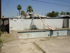 One of the ugliest empty pools I have ever seen. empty swimming pool slide bad MLS photos Phoenix home house real estate