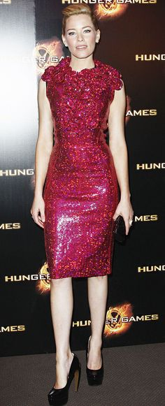 """Elizabeth Banks in Marc Jacobs Fall 2012  pink sequined dress with oversized floral accent and Walter Steiger patent pumps. """"The Hunger Games"""" Paris Première 2012."""
