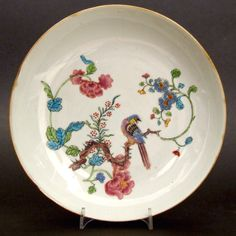 A Plain Chinese Export Porcelain Saucer Shaped Dish, Yongzheng or Early Qianlong Period c.1730-1750. Decorated in Holland c.1730-1750 in the Chinese Famille Rose Style with a Bird on a Branch.