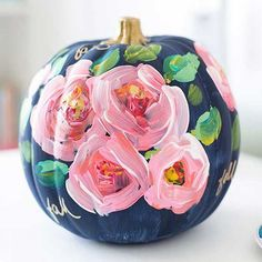 If the ooh and goo of carving pumpkins doesn't put you in the Halloween spirit, grab a paintbrush instead. Painted pumpkins can be as festive or as chic as you want and customized to fit any decorating style.