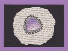 Purple gem on book page.