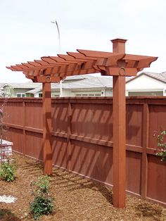 This is a simple redwood pergola built of 2x CON HRT REDWOOD S4S and stained with a tinted transparent stain. It consists of 6x6 posts, 2x6 ...