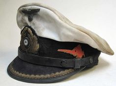 This Hat would have been worn by u-boat U-96 captained by Kptlt. Heinrich Lehmann-Willenbrock  This is a first class reproduction of a Kriegsmarine U-Boat Commanders Peaked Hat with 70+ years of ageing.  The peak, liner and badge etc. all show good wear and the 'Sawfish' - the emblem of U-96 is heavily rusted and paint is flaking from it.  This is a high quality aged peaked Hat from a U-Boat Captain! www.warhats.com