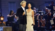 """Tenor Andrea Bocelli and singer Nicole Scherzinger sing a Spanish-language version of """"Don't Cry for Me Argentina,"""" a song originally written for the musical Evita by the team of Andrew Lloyd Webber and Tim Rice. The film version based on the musical opened on December 25, 1996. It starred Madonna (Evita Perón), Antonio Banderas (Ché), …"""
