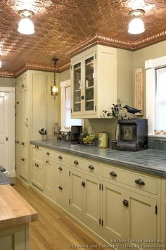 Idea of the Day: A vintage kitchen with a copper ceiling and tile countertop. (By Crown Point Cabinetry) Kitchen Cabinetry, Kitchen Tiles, New Kitchen, Tin Ceiling Kitchen, Kitchen White, Kitchen Ceilings, Rustic Cabinets, Antique Cabinets, Copper Kitchen