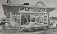Here was the McDonald's drive-in restaurant on 24th Ave, in Port Huron, MI during 1968. It was an original outside stand-up restaurant, but as you can see in the middle, they added a glass front for year-round use. You ate your 15-cent burgers in your car, took 'em home or ate at one or two picnic tables out front.