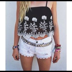 NWT LF crop top NWT LF Charms Fashion Black top with floral white crochet trim super cute top.Lower offsite. LF Tops Crop Tops