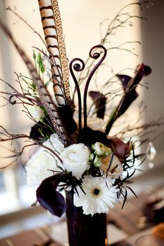 Art Deco/Old Hollywood Affair Wedding Decor. Love the flowers mixed with the pheasant feathers! Feather Centerpieces, Wedding Centerpieces, Wedding Decorations, Table Decorations, Art Deco Wedding, Floral Wedding, Wedding Flowers, Feather Bouquet, Jewel Tone Wedding
