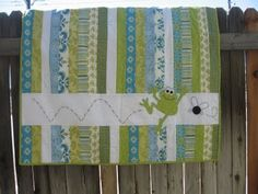 I like this stripe quilt but with an airplane instead of the frog. hmmm...