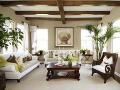 Formal Yet Cozy Living Room: The commitment to large formal spaces, a rarity, manifests itself in this large, self-contained living room, which interrelates with the side courtyard. From HGTVRemodels.com