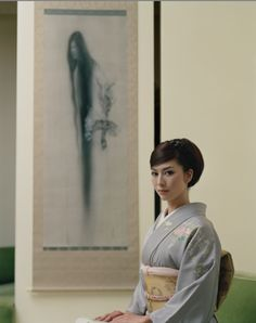 Japanese painter, Fuyuko Matsui with her drawing of a ghost.