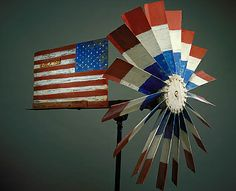 American Flag Whirligig, mid 20th century, unidentified artist, painted iron and carved and painted wood 28 1/4 x 38 1/2 x 28 1/4 in. (71.8 x 97.8 x 71.8 cm.), Smithsonian American Art Museum, Gift of Herbert Waide Hemphill, Jr. and museum purchase made possible by Ralph Cross Johnson 1986.65.371