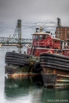 Tugs and Memorial Bridge. The Moran Towing tugboats are the silent residents and workhorses of the Piscataqua River, Portsmouth, New Hampshire. Photo by Philip Case Cohen - (V)