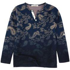 Jersey en coton imprimé fantaisie et coloris Tie and Dye. Encolure tunisienne avec patte boutonnée devant. Manches longues retroussables par languettes boutonnées. Une poche placée sur la poitrine. - 32,90 €