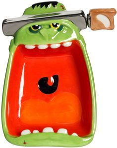FRANKY BOWL WITH SPREADER Fill up Franky with your favorite spreadable delights! This mean, wide mouthed ceramic Franky head features a spreader that goes right through his noggin'. $19.00 #housewares #bowl #frankenstein