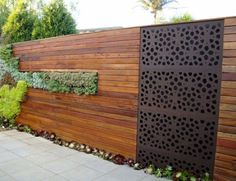 Outdoor Privacy Screens by Outdeco in the Marakesh Design feature in the timber panelling privacy fence with a vertical garden with succulents. Designed by Vertiscape - Living Holmes Design