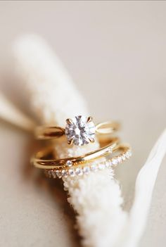 She's got it all! Our Ada engagement ring is classy and timeless with a vintage feel. Created with a 2.5mm shank and low profile setting. Set her with any shape diamond your heart desires! Paired here with the Moonflower and Small Auk Band for a sled, modern turn.