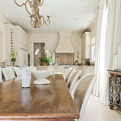 My new house is like this- one long room for the kitchen and dining room. paint is BM Manchester tan     A kitchen designed by Leah Richardson w/ 10' long farm table. Calming and soft color