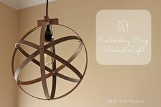 Incredible DIY light fixture using embroidery hoops!