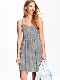 I own several of this dress in solids and patterns. The length is great and the elastic at waist helps define my waist. I usually pair with a cardigan or jacket for work.