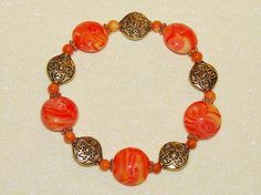 BEADED STRETCH BRACELET-HANDCRAFTED-LAMPWORK-GOLD-ORANGE-PEACH-WHITE-& FREE GIFT-$11.99 | eBay