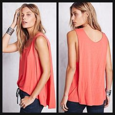 """Free People Caped Top swingy cape sways from the back of this effortless silhouette, rendered in a soft linen blend. Simi Sheer and lightweight linen top with dropped armholes and a drapey back. High low raw hem.  Scoop neck Sleeveless Open side seam Pullover About 35"""" from shoulder to hem Rayon/linen Hand wash Orange WILL TRADE FOR NIKE DRI FIT PRO SHORTS OR VSPINK ITEMS Free People Tops Tank Tops"""