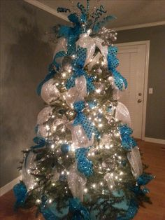 Christmas tree with teal & silver deco mesh. Love my tree!