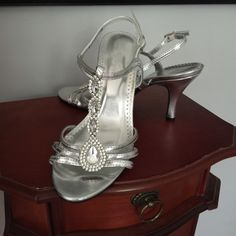 4dfbc61ebb26 Silver Shoes Alfred Angelo Silver shoes with pretty rhinestones and lots of  bling. These are in excellent condition and only worn once Alfred Angelo  Shoes