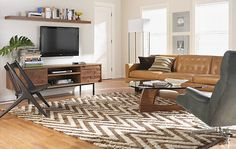 Environments-TV in living room. Affected couch arrangement/dynamic of room.