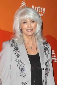 Looking for a cut to show off your silver locks? Try face-framing layers like Emmylou Harris.  Check out the 5 best haircuts for gray hair.