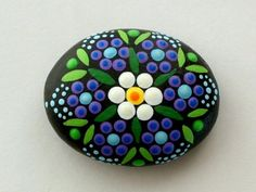 Ready to ship! Hand painted rocks, mandala stones in shades of blue amethyst purple green and teal on a black background. This stone is perfect size to place in a random flower pot or a mini desktop Zen garden, yoga accessories. Bring Zen and a surprise to a best friend, co-worker or boss! A unique birthday or get well gift idea for the yoga enthusiast, for meditation to align chakras for energy and creativity. A thoughtful gift for the house sitter while you travel. Unique college dorm…